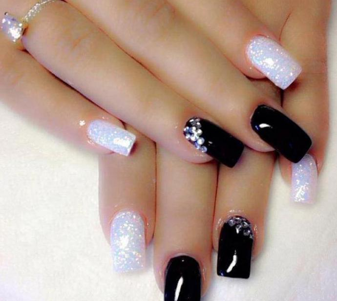 black manicure with pebbles