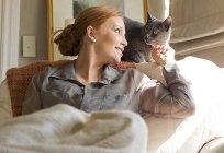 How cats treat people and what ailments?