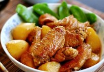 A delicious and hearty chicken wings with potatoes in the oven